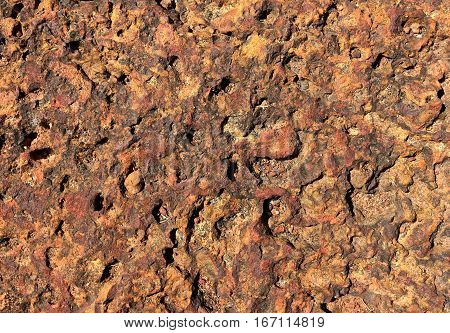 Red and Rusty Volcanic Stone Texture and Background