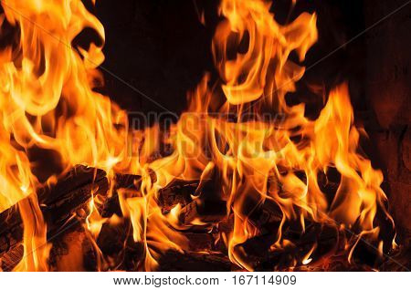 Fire flames on dark background. heat and flame of fire in the fireplace