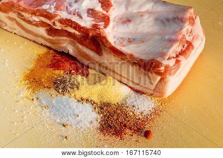 Bacon. Raw Bacon Parsley Herb Salt Pepper And Garlic.stll Life Studio Shot.