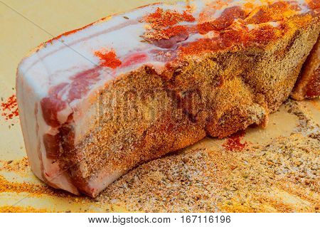Raw Bacon With Spices On Wooden Table