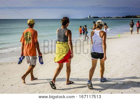 Siesta Key FL USA - November 16: People walking along Crescent beach at Siesta Key Island in Sarasota FL