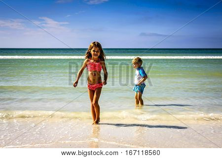 Siesta Key FL USA - November 18: Two young children playing in the Gulf of Mexico and Siesta Key beach in Florida