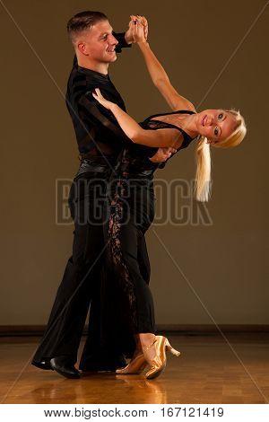 Beautiful Ballroom  Couple Preforms Their Exhibition Dance