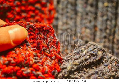 Background of knitting red and blue patterns, knitting wool texture background close-up, macro