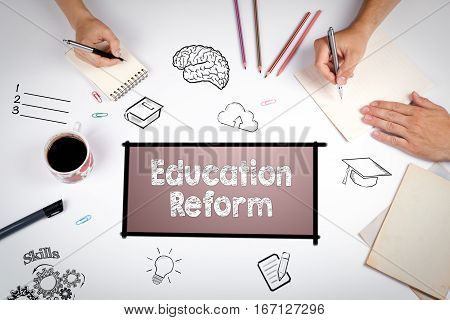 Education Reform Concept. The meeting at the white office table.