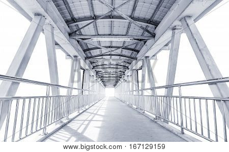Light from the way out of modern metal structure bridge or overpass walk way
