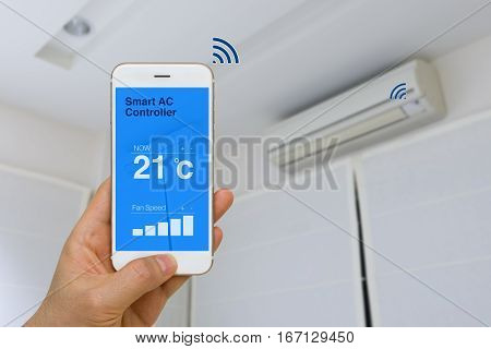 Concept of IOT remotely controlling smart air conditioner with app on smartphone from distance.