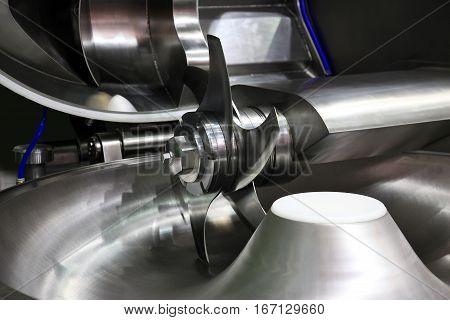 Industrial meat grinder close up - mincing-machine