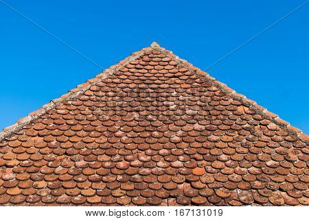 Low view of the very old ceramic tile roof