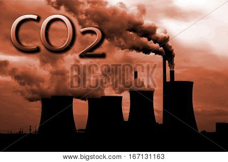 Smoke of chimney writing CO2 in the sunset sky