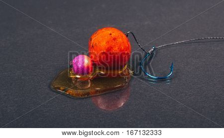 Carp Hook Boilies With Dip . Closeup .
