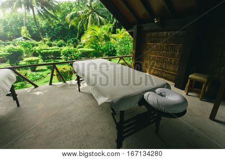 Spa beds ready to massage at outdoors tropical island resort