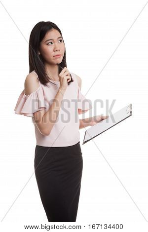 Young Asian Business Woman Thinking With Pen And Clipboard.