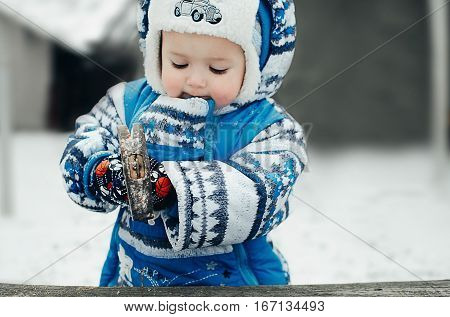 baby hammering nails into a wooden surface very entertaining