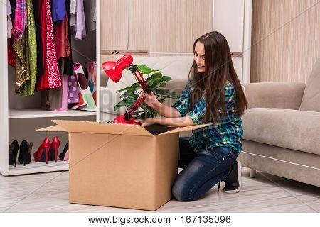 Young woman packing personal belongings