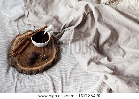 On The Bed Is A Tray Of Coffee