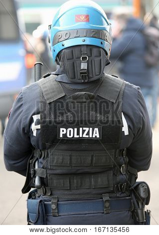 Vicenza, Vi, Italy - January 28, 2017: Italian Police Riot Squad With Blue Helmet While Patrolling T