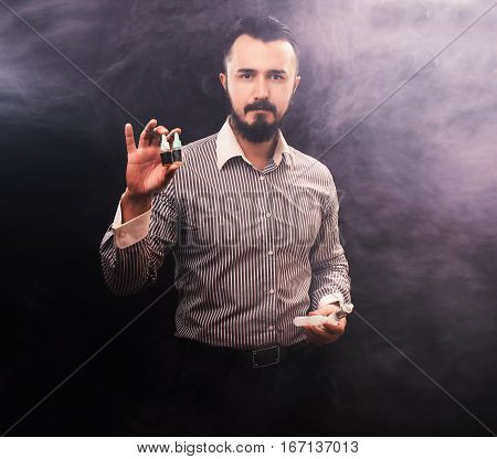 vaper fashion man holding e-liquid, vapor concept