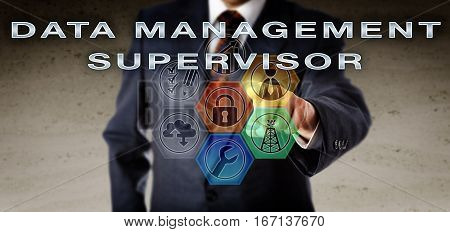 Recruitment manager in blue business suit pressing DATA MANAGEMENT SUPERVISOR on an interactive virtual control interface. Oil and gas industry job dealing with file integrity and document control.