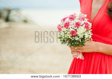 Woman Holding A Bridal Bouquet. Bridesmaid Took Wedding Flowers