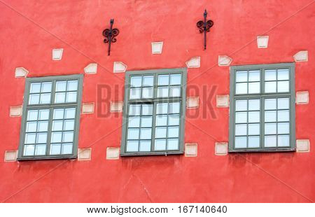 Windows of red iconic buildings on Stortorget, a small public square in Gamla Stan - the old town in central Stockholm ,Sweden