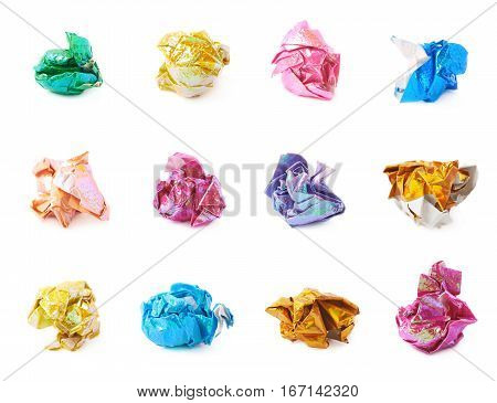 Crumbled ball of colorful origami paper sheet isolated over the white background, set of multiple different foreshortenings and color variations