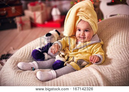 Child After Bath. Cute Little Girl With Wet Curly Hair Wearing A Bathrobe And Head Towel Sitting