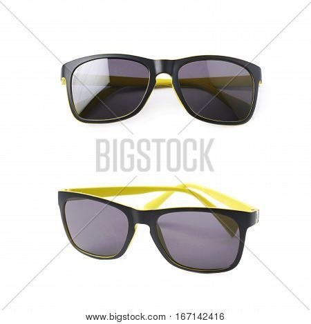 Pair of yellow plastic sunglasses with the dark shades, composition isolated over the white background, set of two different foreshortenings