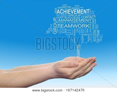 Concept or conceptual business text word cloud on man hand, tagcloud on blue sky background