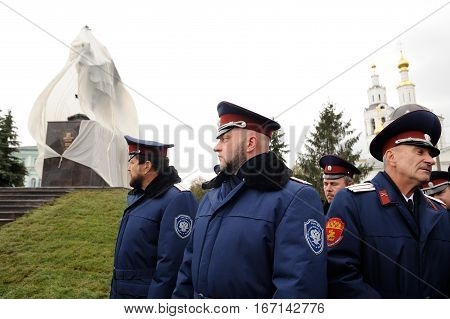 Orel Russia - October 14 2016: Ivan the Terrible monument opening ceremony. People in cossack uniform and Ivan the Terrible monument closeup