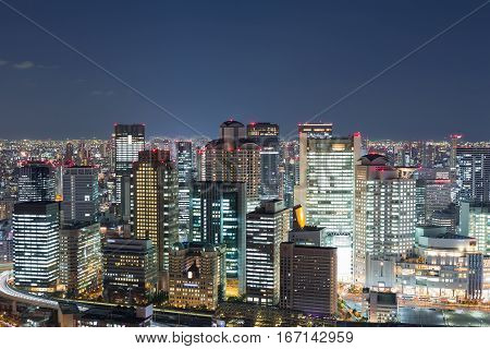 Osaka city business downtown view from Umeda sky building at night Japan