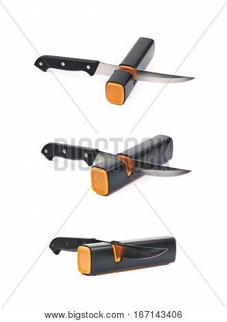 Knife in a plastic black sharpener tool, composition isolated over the white background, set of three different foreshortenings