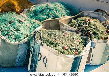fishing net in a fishing boat on sunset