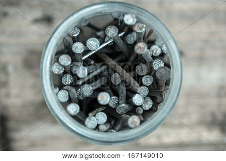 Together - we are force. The idea of photo nails bank meaningful unity of the Spirit. Nails in a glass jar.