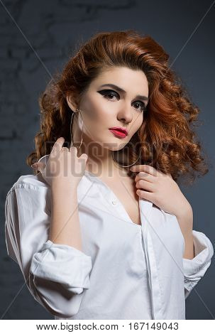 portrait of a beautiful girl with makeup in a white swordsman in the studio