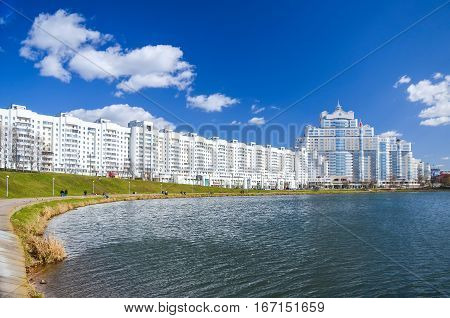 Belarus, Minsk - April 09/2015: With The Advent Of Spring Sun The Townspeople Go To The Embankment O