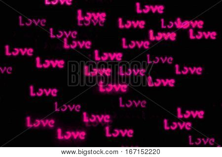 Love St Valentines day background with pink word Love bokeh - love postcard for St Valentines day