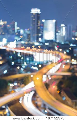 Abstract blurred bokeh highway interchanged and office building background night view