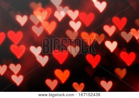 Romantic love red heart bokeh background with defocused light hearts - love heart background
