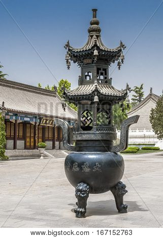 China Xi'an. Giant Wild Goose Pagoda is located in the Da Ci En Temple which was built in the middle of the seventh century. Censer for kindling incense.