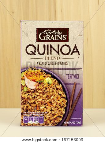 RIVER FALLS,WISCONSIN-JANUARY 28,2017: A box of Earthly Grains brand Quinoa and Brown rice mix with a wood background.