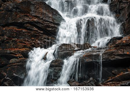 Water jets in a waterfall in the forest of Carpathian mountains. Ukraine Europe