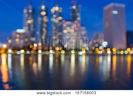 Abstract blurred lights office building and reflection with twilight sky background