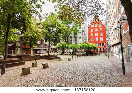 The cozy patio with green in the center of Cologne, Germany. Houses in Bavarian style.