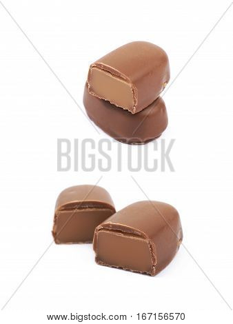Chocolate coated toffee candy sliced in two parts, composition isolated over the white background, set of two different foreshortenings