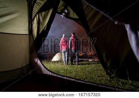 View From Inside Tent On Couple Hikers At Night Camping
