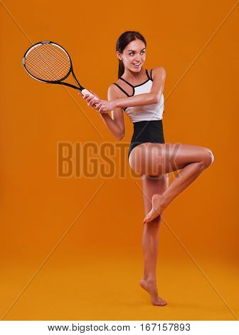 Female Tennis Player Reaching To Hit The Tennis Ball