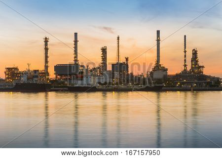 Refinery river front with sunrise sky background and tone