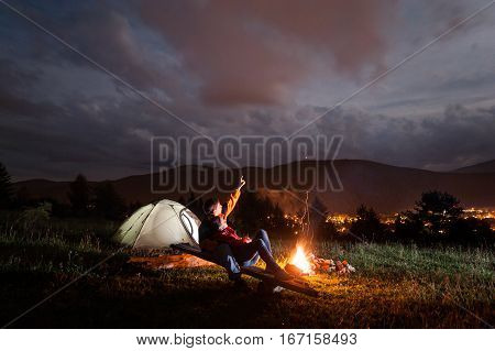 Guy Shows His Lover In The Night Cloudy Sky