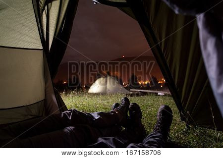 Romantic Couple Lying In Tent With View Of Night Camping